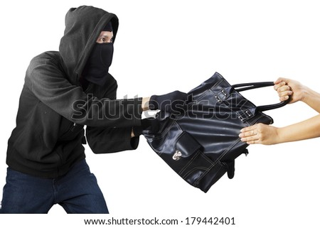 Thief stealing handbag from a woman. isolated on white - stock photo