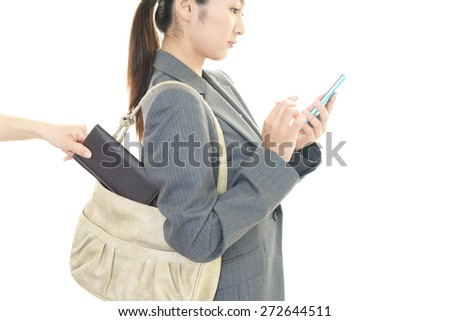 Thief steals a wallet - stock photo