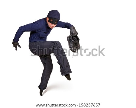 thief walking on tiptoe burglar mask stock photo edit now 158237657 shutterstock. Black Bedroom Furniture Sets. Home Design Ideas