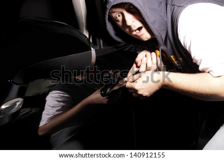 thief was caught stealing car - stock photo
