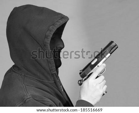 Thief with a Gun - stock photo