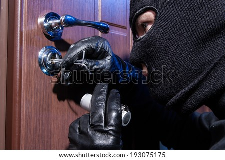 thief with a passkey - stock photo
