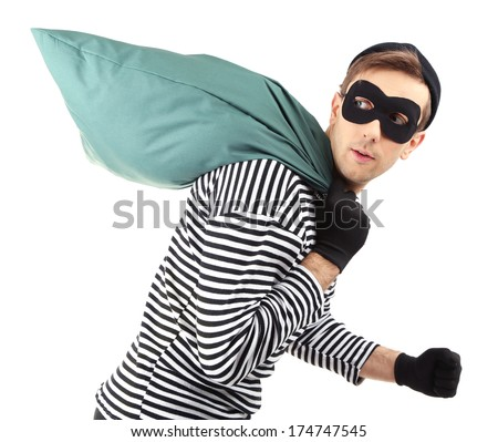 Thief with bag, isolated on white - stock photo