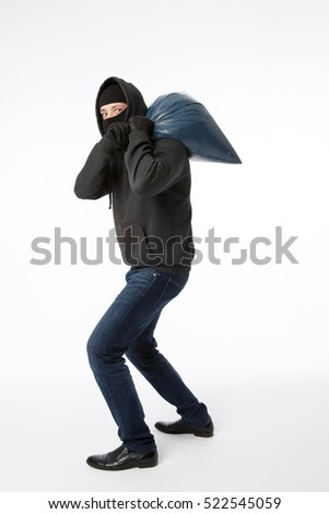 Thief with bag on shoulder