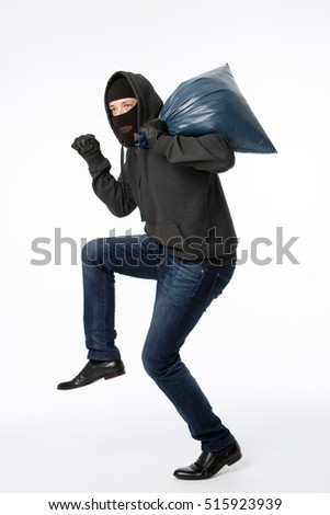 Thief with big blue bag