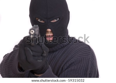 thief with gun aiming into a camera - isolated on white background