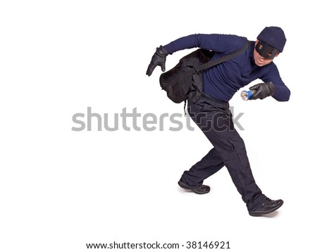 thief with hand torch - stock photo