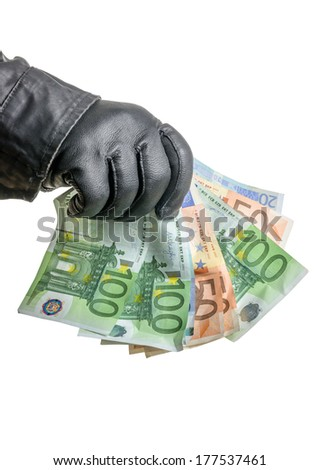 Thief with leather glove is grabbing some bills - stock photo
