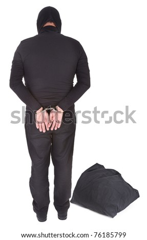 thief with sack handcuffed on white background, view from behind - stock photo