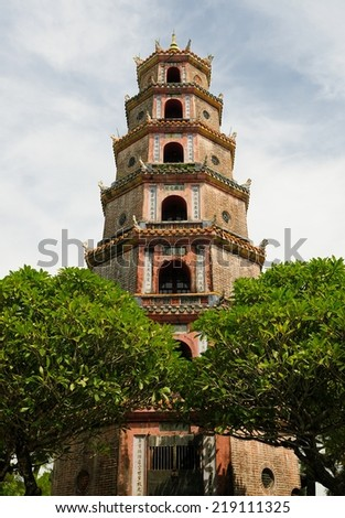 Thien Mu Pagoda is a historic temple in the city of Hue in Vietnam. Its pagoda has seven storeys and is the tallest religious building in Vietnam. - stock photo