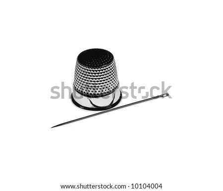 thimble and needle on the white background