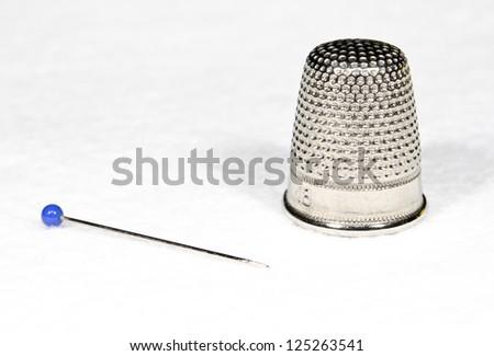 thimble with pin - stock photo