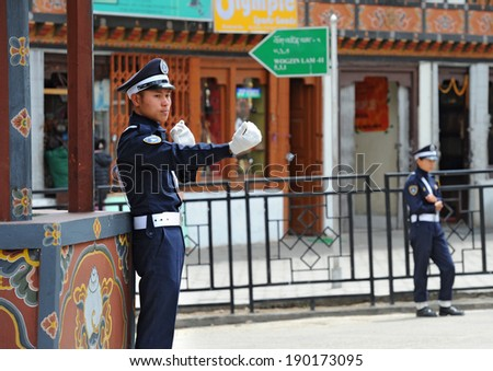 THIMPHU - APRIL 5: Traffic police regulating traffic on April 5, 2014 in Thimphu, Bhutan. Thimphu is the world's only capital without traffic lights. - stock photo