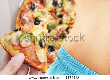 thin body woman with pizza background