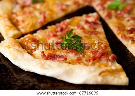 Thin French Style Pizza with Ham and Cheese - stock photo