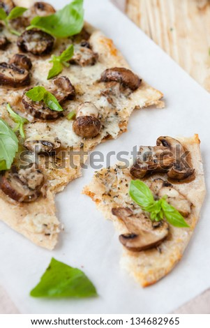 thin homemade pizza with cheese and mushrooms, food - stock photo
