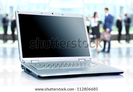 thin laptop on office desk - stock photo
