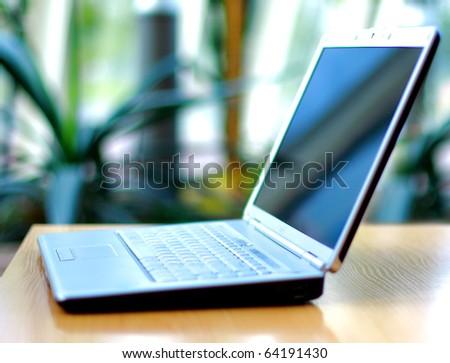 thin laptop on office desk - stock photo