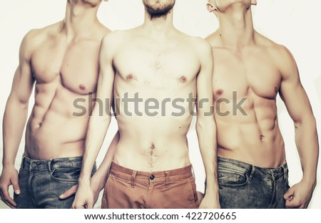 Thin torso between two men with sporty athletic muscular strong sexy body in studio isolated on white background - stock photo