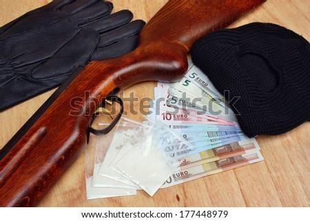 Things bandit criminal drug dealer gun, balaclava, gloves euro money on the table - stock photo