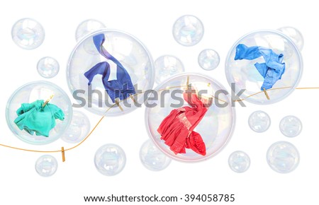 things falling in soap bubbles on a white background concept of clean washing and freshness