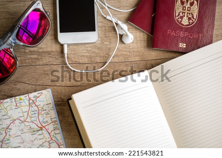 things necessary for vacation  on wooden table  - stock photo