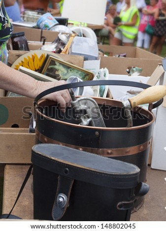Things put up on tables for a flee market or auction - stock photo