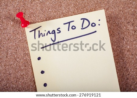 Things To Do List pinned to a Noticeboard. - stock photo