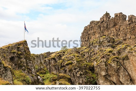 THINGVELLIR, ICELAND - SEPTEMBER 12:  The Iceland flag flies over Thingvellir National Park in Iceland.  The site is of geological importance and is pictured on September 12, 2015.