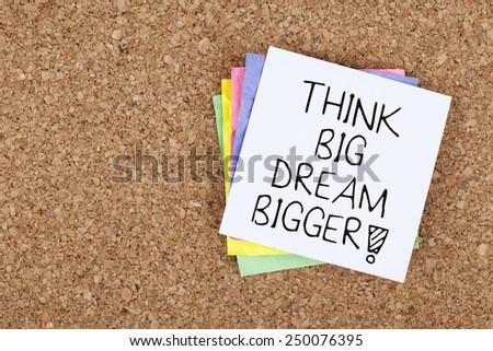 Think Big Dream Bigger / Motivational Note - stock photo