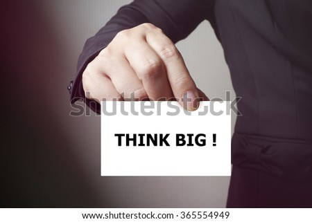 THINK BIG paper on the card , business concept , business idea - stock photo