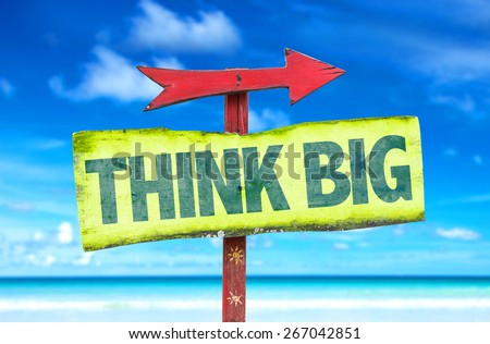 Think Big sign with beach background - stock photo