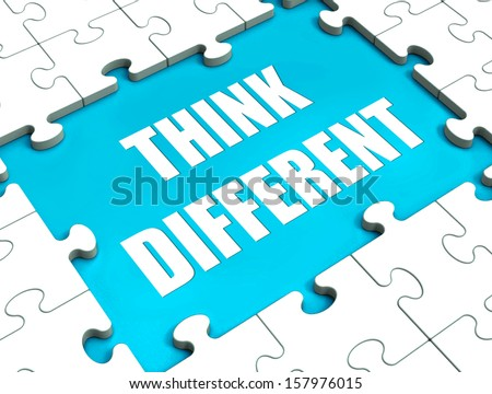 Think Different Puzzle Showing Thinking Outside the Box - stock photo