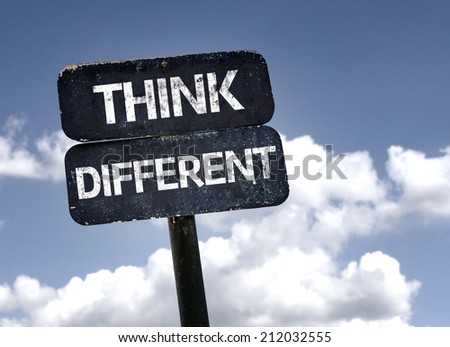 Think Different sign with clouds and sky background  - stock photo