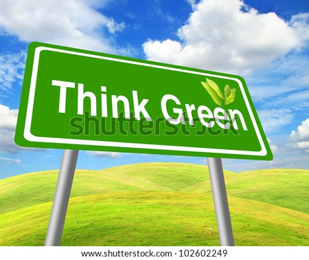 Think green sign over grass field and blue sky - stock photo