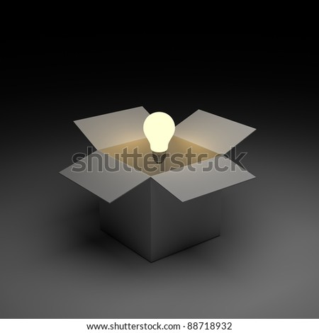 Think out of the box or thinking outside the box concept, Glowing light bulb float over opened cardboard box - stock photo
