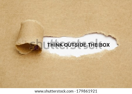 Think Outside The Box appearing behind torn brown paper.  - stock photo