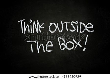 Think Outside The Box, written with Chalk on Blackboard - stock photo