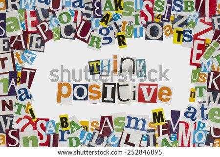 Think Positive letters cut from newspaper - stock photo