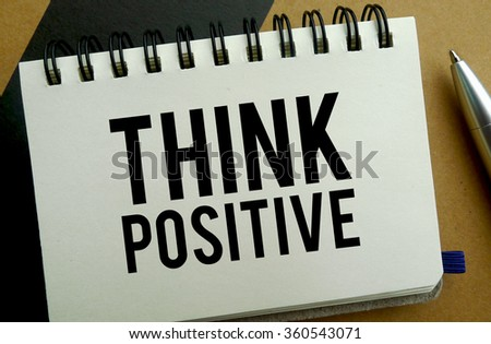 Think positive memo written on a notebook with pen