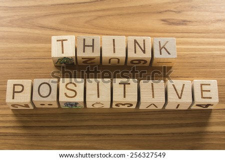 Think Positive on a wooden background - stock photo