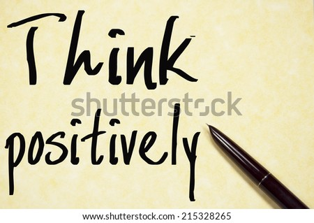 think positively text write on paper  - stock photo