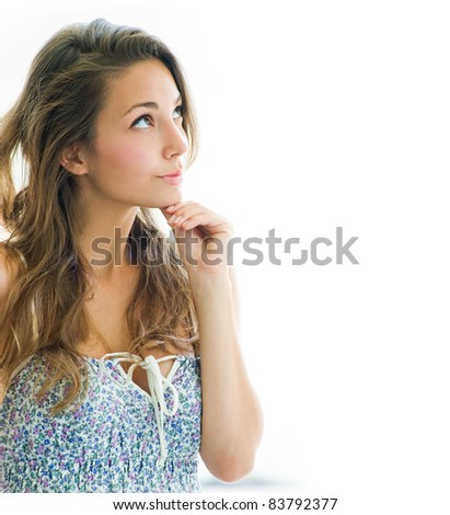 Thinking about - portrait of beautiful pondering brunette girl with copy space on white background. - stock photo