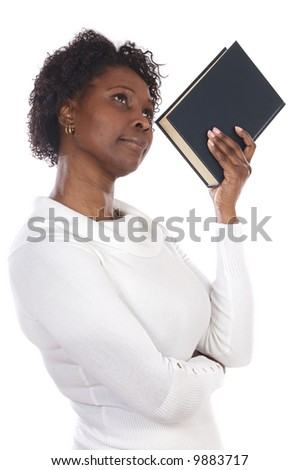 Thinking attractive woman with a book a over white background - stock photo