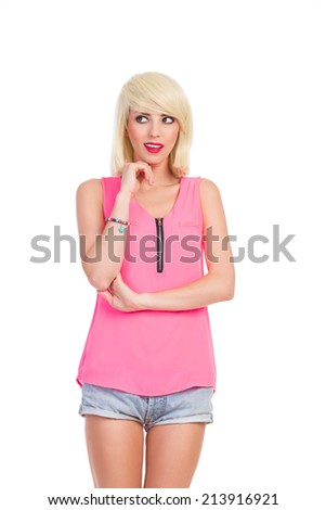 Thinking beautiful blonde young woman, holding hand on chin and looking away. Three quarter length studio shot isolated on white. - stock photo