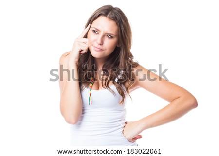 Thinking beautiful young woman on white background - stock photo