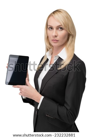 Thinking blonde business woman looking for something using a tablet. Isolated on white background.  - stock photo