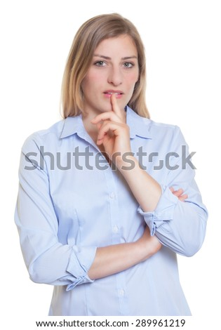 Thinking blonde german woman in blue blouse  - stock photo