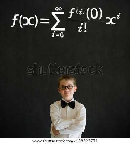 Thinking boy dressed up as business man with maths equation on blackboard background - stock photo