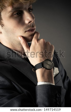 thinking business man in a suit - stock photo